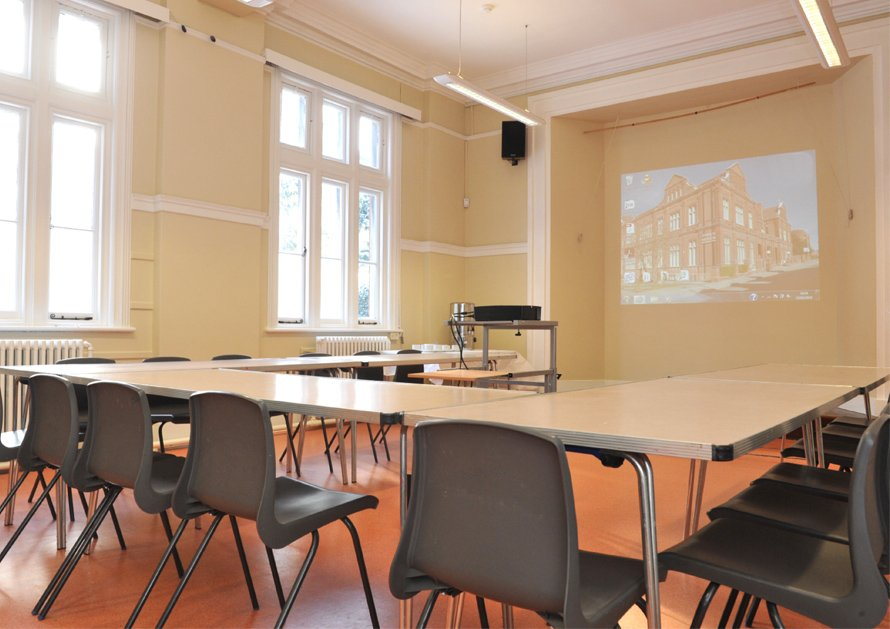 Ipswich Museum Education Room set up in horseshoe for business meeting