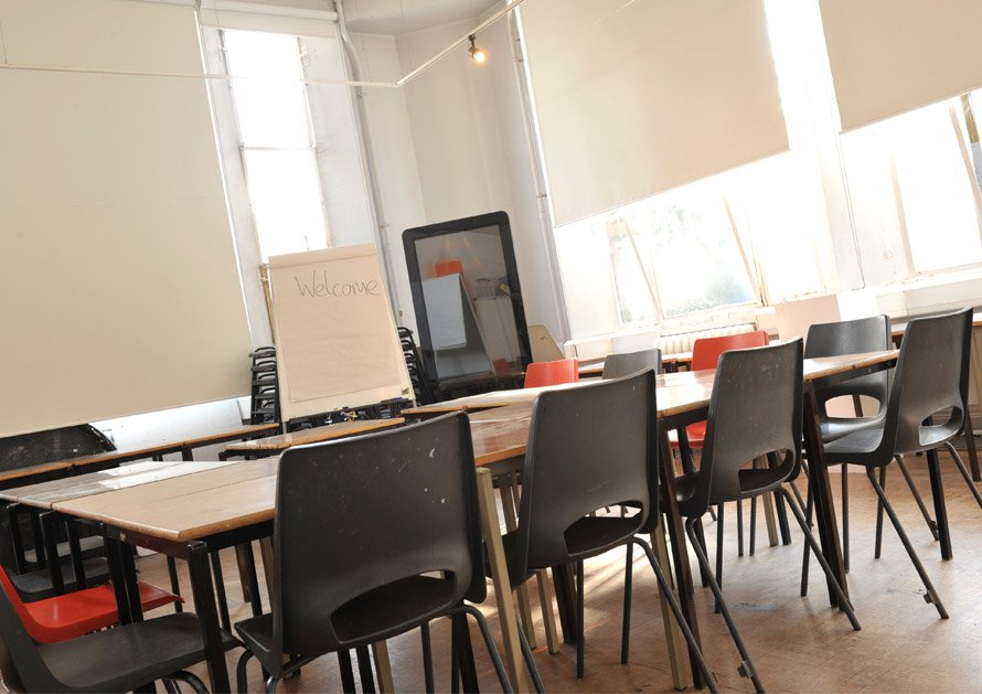 Ipswich Art Gallery Learning Studio set up in horseshoe for business meeting