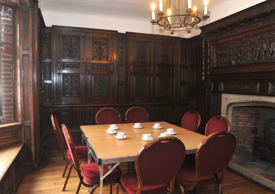 Table and chairs set up in room at Christchurch Mansion